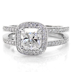 Split shank micro pave halo engagement ring with cushion cut center diamond