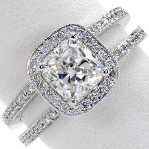 Cushion cut center diamond in a micro pave split shank halo design engagement ring