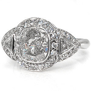 Custom bezel set cushion cut with bezel set triangle shape diamonds engagement ring