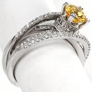 Yellow Round Cut Sapphire in a very unique micro pave split shank engagement ring