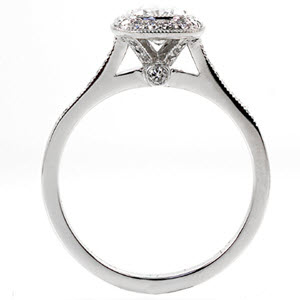 Bezel set cushion cut engagement rign with raised halo