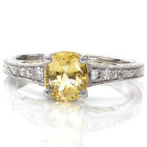 The Number One Ring from Our Top Ten Most Beautiful Ring List is our Barcelona design shown here with a yellow cushion cut sapphire  center stone and yellow gold filigree.
