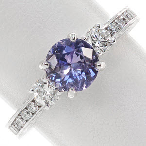 Three Stone Engagement Ring Design with a purple sapphire.