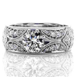 Vintage Style Engagement Ring with low set center diamond and hand cut pave set diamonds.