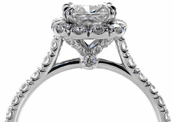 Hand cut micro pave engagement ring with hand cut halo &amp; claw prongs
