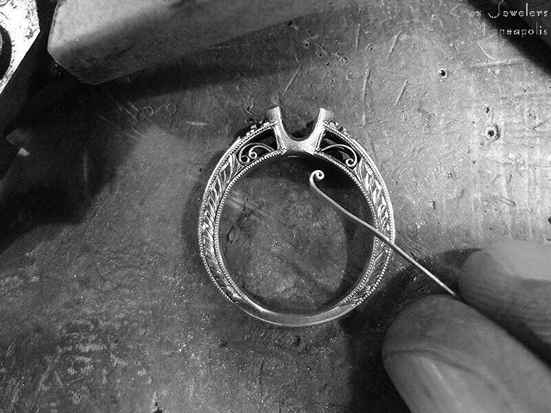 Master jeweler crafting a filigree engagement ring