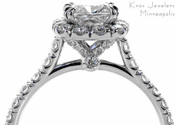 Hand cut micro pave engagement ring with hand cut halo & claw prongs