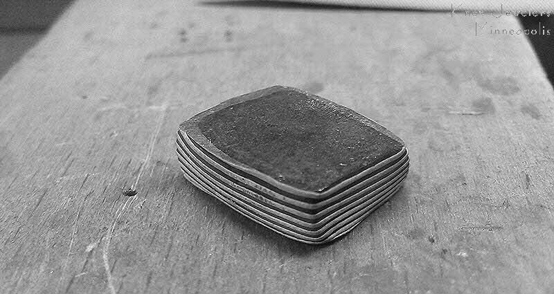 Mokume gane billet of gray gold and sterling silver after firing