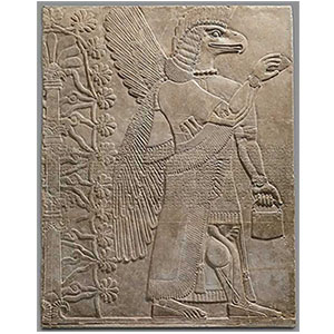 Ancient Assyrian releif engraving features an intricate represenation of an eagle-headed man carved into a stone panel.