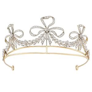 This stunning two-tone tiara is comprised of three ribbon bow motifs, garland swags and diamonds on a yellow gold frame.
