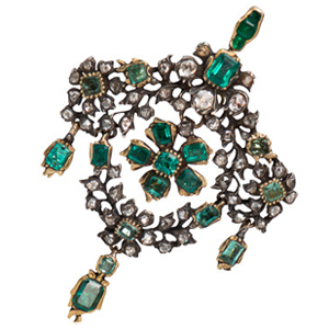 This stunning Georgian Era fashion piece features bezel set green emeralds in yellow gold to compliment the warm color tones.