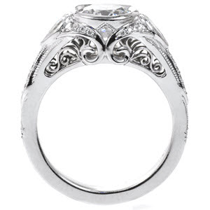 Custom engagement ring design created by Knox Jewelers featuring hand formed filigree curls and pear shaped side diamonds.