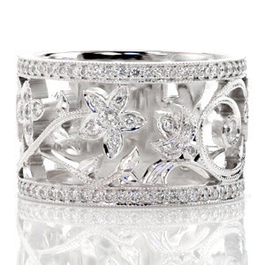 Custom wide band ring design created by Knox Jewelers featuring nature inspired patterning and bead-set diamond rails.