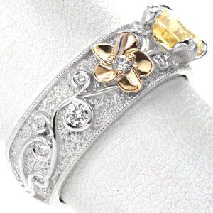A flowing scroll pattern intricately fashions round brilliant diamonds and interweaves floral motifs and petal prongs.