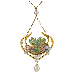 Antique nature inspired necklace featuring Art Nouveau era detailing including a cloisonne enameled leaf and natural pearls.