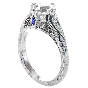 This Stunning Platinum Engagement Ring Has Intricate Scroll Releif  Engraving Above A Hand Applied Stippled Background