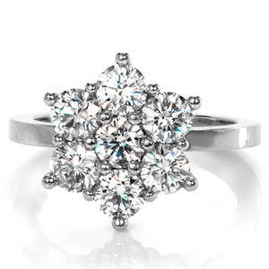 This vintage inspired cluster diamond ring creates a stunning floral arragment with a center stone surrounded by a halo of brilliantly faceted diamonds.