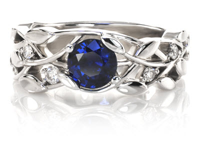 blue sapphire engagement ring shown in floral setting with 5 smaller diamonds prong set in 14k - Wedding Rings Without Diamonds
