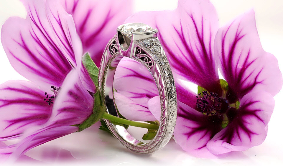 Exquisite half bezel engagement ring adorned with openwork filigree, hand engraving and milgrain