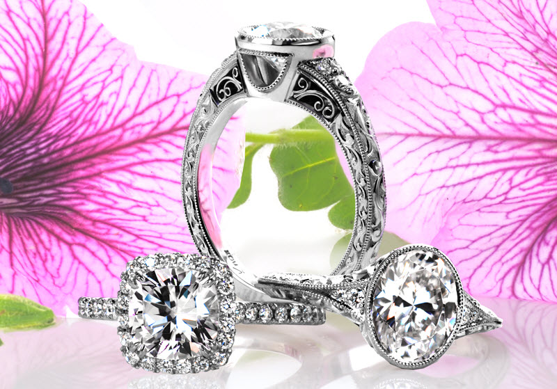 St. Cloud engagement ring with filigree, hand engraving and bezel set center stone.