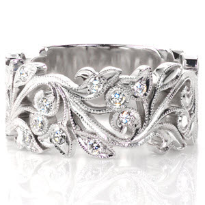 Graceful lines of intertwining leaves and vines adds movement to this art nouveau inspired white gold band.