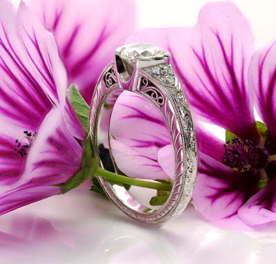 Filigree Engagement Rings shown in platinum with hand engraving.