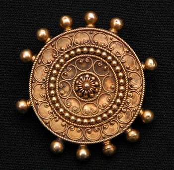 Ancient Etruscan 14k gold brooch featuring granulation and ground-supported filigree