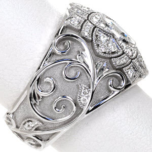 Custom engagement is featured in 14k White Gold with ground-supported filigree and stippled background