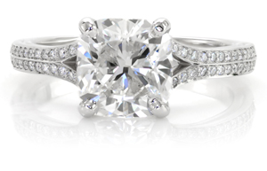 Platinum cushion cut engagement ring.