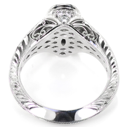 Platinum engagement ring with filigree and hand engraving.