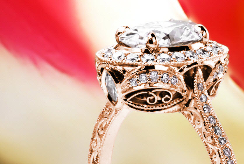San Diego unique antique inspired custom rose gold engagement ring with a diamond halo surround an oval cut center.