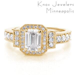 Art Deco engagement ring with emerald cut center stone and yellow gold setting in Oakland.