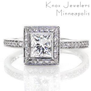 Bezel Elegante is a exquisite square halo design. The 0.75 carat princess cut is exaggerated in size with a halo of micro pavé diamonds framing it. The row of stones along the band magnify the beauty of the brilliant center. Raised high above the band, the halo leaves room for bands on either side.