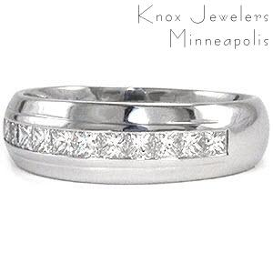 The Long Island band incorporates diamonds into a classic design. Crafted in 14k white gold, a single row of channel set princess cut diamonds total 0.75 carats embellish the top of the band. The domed profile has a single pinstripe that frames the diamonds. The high polished finish completes this classic look.