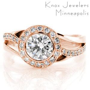 Halo engagement ring in Cleveland with bezel set center stone and milgrain detail.