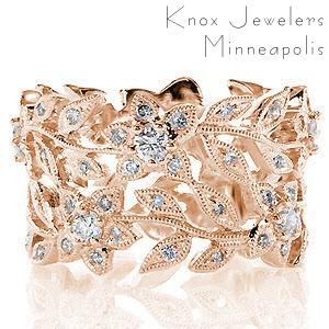 Las Vegas wide band in rose gold with nature inspired patterns and diamonds.