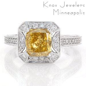 A mesmerizing ring shown with a 1.50 carat yellow cushion cut diamond. This alluring stone is set in a unique halo with a star burst cut-out around the center stone. Under the halo is detailed with unique cut-outs. All the exquisite elements in this ring, are adorned in micro pavé.