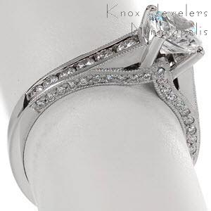 Unique engagement ring in Sarasota with round brilliant center stone, channel set diamond and milgrain detail.
