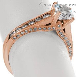Rose gold engagement ring with round brilliant center stone and channel set diamonds in Cleveland.