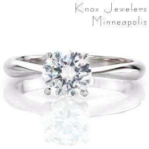 Satin is a gorgeous contemporary solitaire with a 1.0 carat round brilliant diamond. Fashioned between four prongs, the lovely round center stone is a breathtaking sight. The band tapers towards the top of the ring placing all the attention on the exquisite diamond.