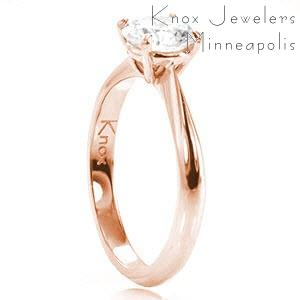 Solitaire engagement ring in Orlando with round brilliant diamond and rose gold setting.
