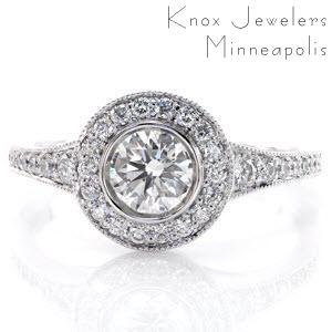 Green Bay engagement ring with bezel set center stone, diamond halo and flared band.