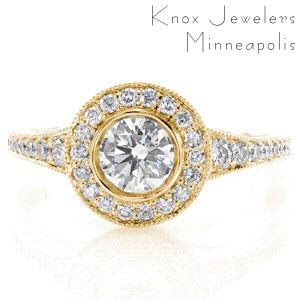 Halo engagement ring in Regina with round brilliant center stone and yellow gold setting.