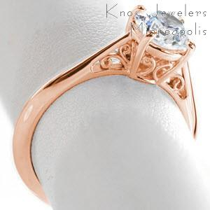 Custom engagement ring in Hudson with scroll filigree and round brilliant center stone.