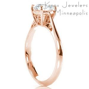 Rose gold engagement ring in Charlotte with filigree and round brilliant center stone.