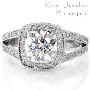 Buffalo engagement ring with cushion shaped halo and a diamond split shank band.