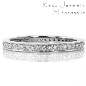 This elegant micro pavé wedding band can be a beautiful accent to any engagement ring or worn on its own. The diamonds are set all the way around the band and beaded milgrain texture adds brilliance around the outer edge of the ring. High polished sides make this ring easy to stack.