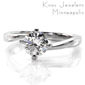 Calgary custom solitaire engagement ring with a round brilliant diamond held in a unique twisted setting.