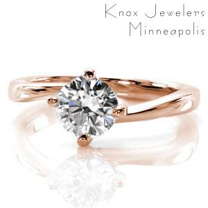 Milwaukee custom rose gold solitaire engagement ring with a round brilliant diamond held in a unique twisted setting.