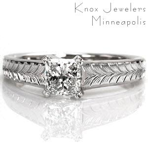 This design features clean lines and charming details to put all the focus on the 0.75 carat princess cut center diamond. The center stone is secured with double prongs and is upraised to show off the side profile of the stone. The wider band is adorned with a beautiful, hand engraved wheat pattern.